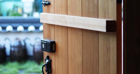 door handle: A doorknob and two locks. Stock Photo