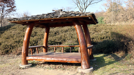 Wood garden pavilion in the park. Stock Photo