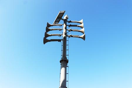 trumpet-shaped speaker against the blue sky