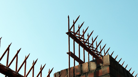 brick wall with barbed wire
