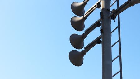 Solar loudspeaker on the blue sky background