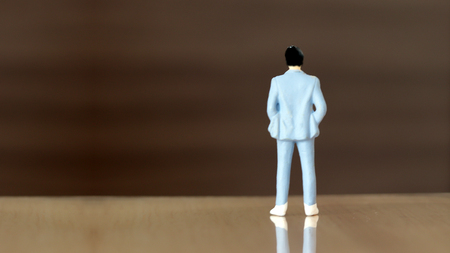 appearance from behind a miniature man Stock Photo