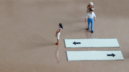 signpost and miniature people