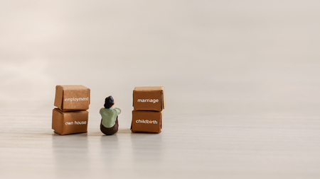The concept of a person who cares about the future. Miniature people and box.