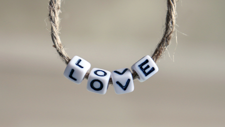 A LOVE alphabet hanging on a rope. Stock Photo