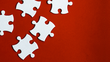 Five puzzles on the red background. Stock Photo