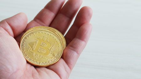 Bitcoin on the palm of the hand.
