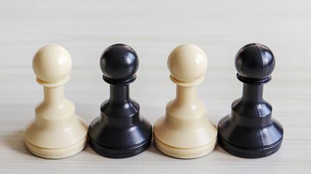 Two white chessman and two black chessman. Stock Photo