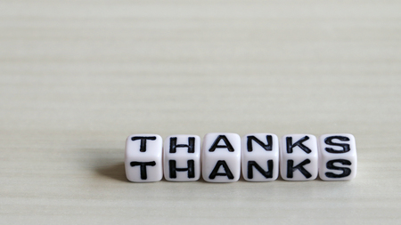 Convey one's thanks. Alphabet cube of THANKS text on the wood background. Stock Photo - 96299257