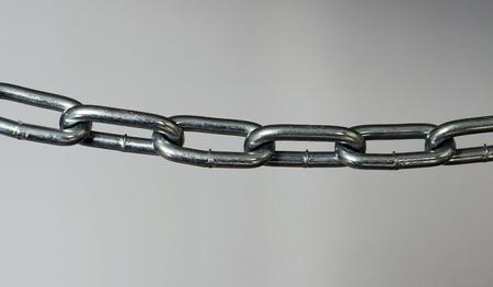A silver metal chain laterally. Stok Fotoğraf
