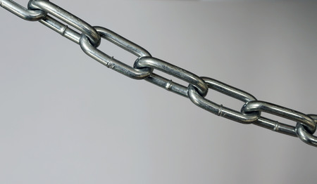 A silver metal chain slanted laterally.