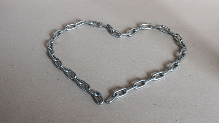 A heart shaped silver metal chain