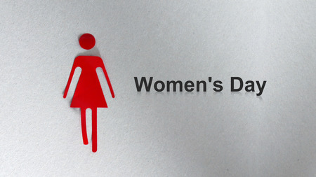 A silhouette of a red woman. The text Womens Day Stock Photo