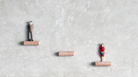 Miniature men and women. Glass ceiling problem concept