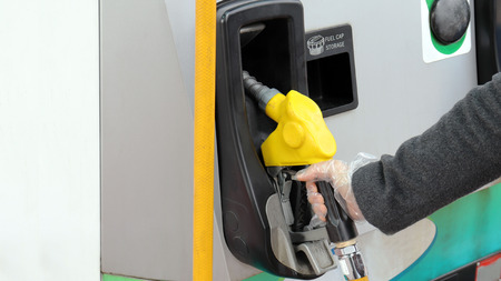Wear antistatic gloves at gas station. Banco de Imagens