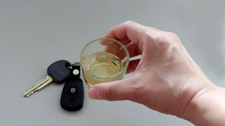 Alcoholic drink and car keys. Do not drink and drive.