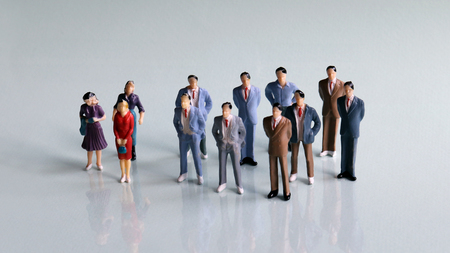 Gender discrimination concept in society. Three women and a bunch of miniature men.