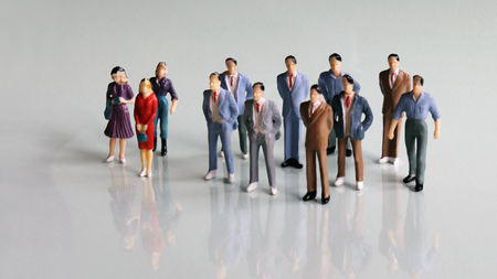 A group of separated miniatures of men and miniatures of women. Stock Photo
