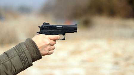 A hand with a gun.