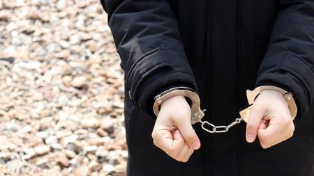 A woman in handcuffs. 写真素材