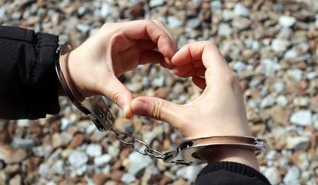 Handmade hearts and handcuffs. Stock Photo
