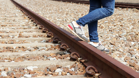The railroad and the both legs.