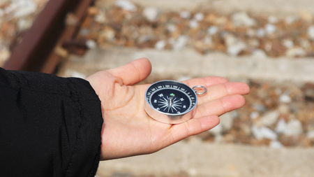 A compass on the palm. Stock Photo