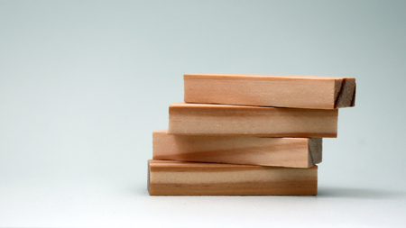 A pile of four wooden blocks.