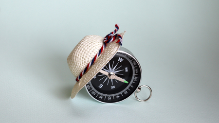 The compass is wearing the white straw hat. Stock Photo