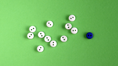 Eleven white buttons and one blue button.