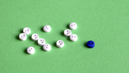 Eleven white buttons and one blue button on the light green background. Stock Photo