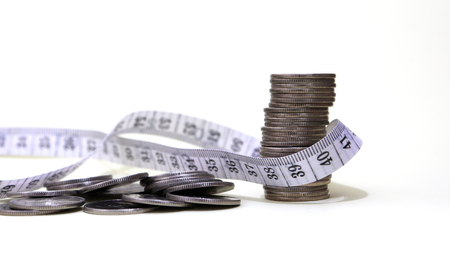 A tape measure and coins.