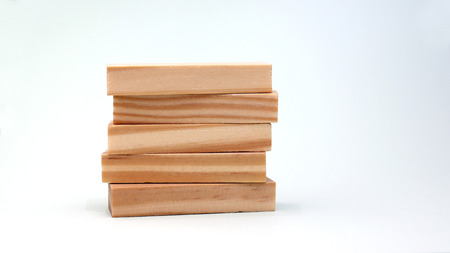 A pile of five wooden blocks on a white background.