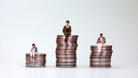A steady wage gap. The relationship between childcare and wage differentials. Stock Photo