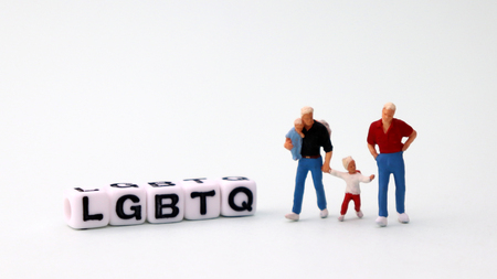 Homogeneous marriages and parenting concepts. White square cube with text 'LGBTQ'