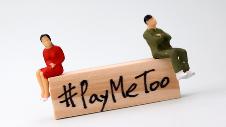 Slanted wooden block written #PayMeToo. A new social movement to bridge the gender gap.