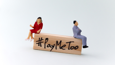 Slanted block of wood written #PayMeToo. A new social movement on the right to equal pay for men and women.