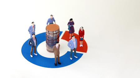 Miniature men and women standing on a donut graph. The concept of gender composition difference in the workplace.