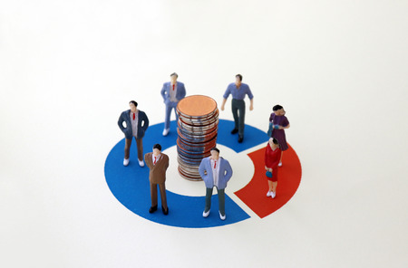 Miniature men and women standing on a donut graph. Gender composition ratio difference concept.