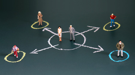 Miniature people each standing in a different circle. The concept of the income gap between individuals.