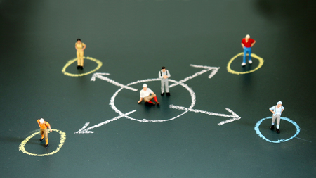 Miniature people each standing in a different circle. The concept of social divergence between people. Stock Photo