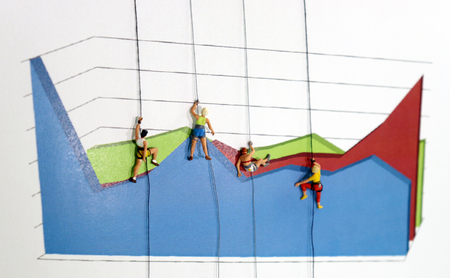 The miniature climbers use a rope to climb the three dimensions area graph. Efforts and competitive concepts to achieve business results.