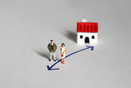 Miniature couple and miniature house in different way.