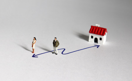 The concept of home and work choice. Miniature people.