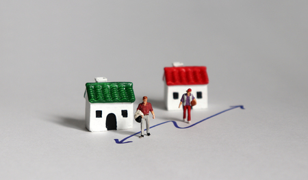 Miniature people and miniature houses. Stock Photo