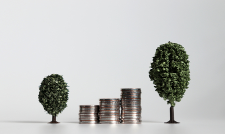 Three piles of coins between two miniature trees.