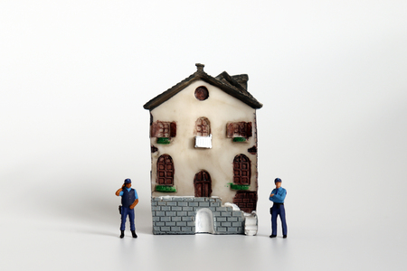 Miniature House and miniature police. Stock Photo