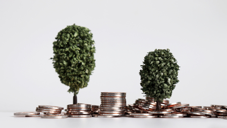 Two miniature trees on a pile of coins.
