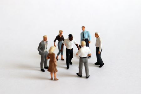 Miniature people. The concept of racial discrimination within the organization. Banco de Imagens - 117500517