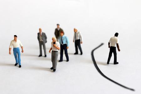The concept of racial discrimination in society. Miniature people. Banco de Imagens
